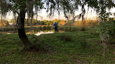 Man Fishing in Pond